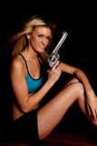 Woman blue halter gun black smile Stock Image