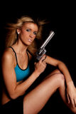 Woman blue halter top gun serious Stock Photo