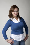 Woman in Blue with Hands on Hips Royalty Free Stock Image