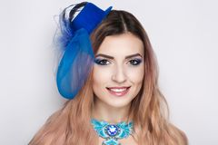 Woman blue hat. Beautiful woman lady model wears fashionable blue hat, big necklace made of beads, crystals. Bright healthy long straight hair. beauty girl face Royalty Free Stock Photos