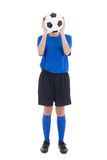Woman in blue holding soccer ball in front of her face Royalty Free Stock Image
