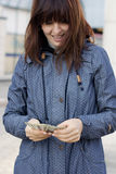 Woman in blue jacket counting money Stock Images