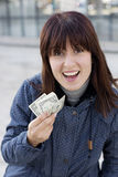 Woman in blue jacket with money Stock Photography