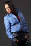 Woman in blue jeans and leather jacket. Sexy young woman in blue jeans and leather jacket Royalty Free Stock Photography