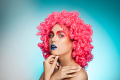 Woman with blue lips and pink wig Stock Photography