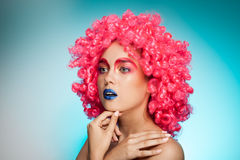 Woman with blue lips and pink wig Stock Photos