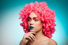 Woman with blue lips and pink wig Royalty Free Stock Image