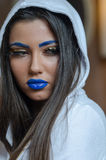 Woman with blue lipstick and unique makeup Stock Photo