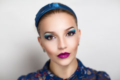 Woman with blue make up Stock Images