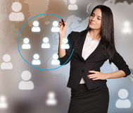 Woman with blue marker has allocated team of icon Stock Images