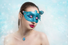 Woman with Blue Mask. Christmas & New Year. Make a wish. Photo with big free blue space, area, place for text, your inscription or buttons (if you use this photo Royalty Free Stock Photography