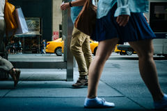 Woman in Blue Mini Skirt Near Man Wearing Brown Pants Stock Photography