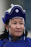 Woman in blue mongolian clothes Royalty Free Stock Image