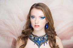 Woman blue necklace bright make up stock image