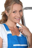 Woman in blue overalls Royalty Free Stock Photo