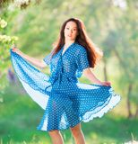 Woman in blue polka-dot dress royalty free stock photos