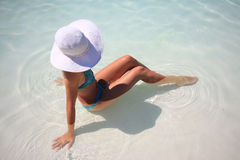 Woman in blue pool Stock Image