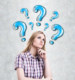 Woman and blue question marks Stock Photography