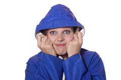 Woman in blue rain coat looking pessimistic Stock Image