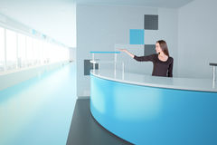 Woman at blue reception desk Stock Images
