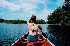 Woman in Blue and Red Bikini Paddling on Boat Royalty Free Stock Image