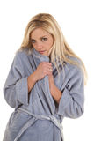 Woman blue robe shy Royalty Free Stock Photos