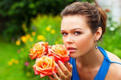 Woman in blue with roses Stock Image