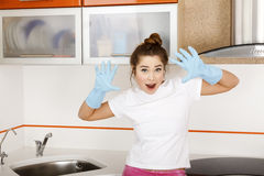 Woman in blue rubber gloves Royalty Free Stock Photo