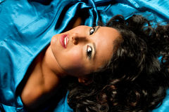 Woman with blue satin Royalty Free Stock Images