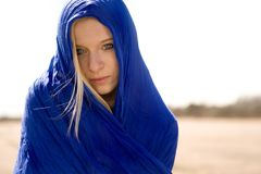 Woman in blue scarf Stock Images