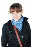 Woman with a blue scarf. Beautiful young woman in black coat with blue scarf isolated on white background royalty free stock images