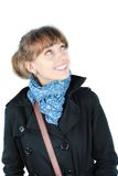 Woman with a blue scarf. Beautiful young woman in black coat with blue scarf looking up isolated on white background stock photography