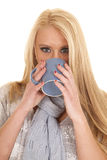 Woman blue scarf and mug drink Royalty Free Stock Images