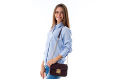 Woman in blue shirt with bag Royalty Free Stock Image