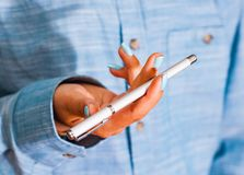 Woman in blue shirt Hold pen in your hand. pen spinning Stock Photo