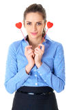 Woman in blue shirt holds two small hearts Stock Photography