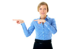 Woman in blue shirt points to the left, isolated Royalty Free Stock Photos
