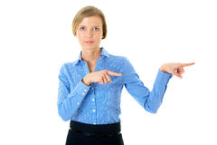 Woman in blue shirt points to the right, isolated Royalty Free Stock Photos