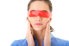 Woman in blue shirt and red ribbon on her eyes Stock Photos