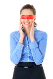 Woman in blue shirt and red ribbon on her eyes Royalty Free Stock Images