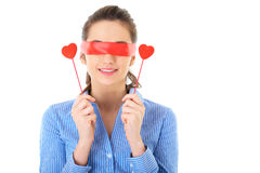 Woman in blue shirt and red ribbon on her eyes Stock Photo