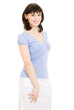 A woman in a blue shirt and white skirt Stock Photo