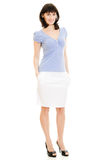 A woman in a blue shirt and white skirt Royalty Free Stock Images