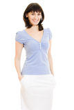 A woman in a blue shirt and white skirt Royalty Free Stock Photography