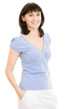 A woman in a blue shirt and white skirt Royalty Free Stock Photos