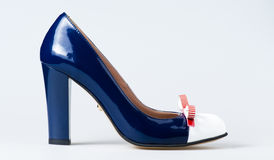 Woman blue shoes on white. Background Royalty Free Stock Photo