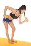 Woman blue shorts weights lean forward Stock Photography
