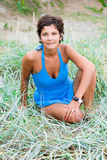 Woman in blue sitting in a grass Stock Photo