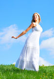 Woman and blue sky Royalty Free Stock Image