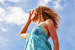 Woman on blue sky background Stock Photo